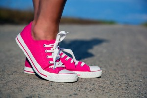 Pink sneakers on girl, woman legs